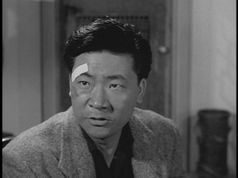 "Victor Sen Yung as Harry Wong in ""The Riddle of the Chinese Jade"""