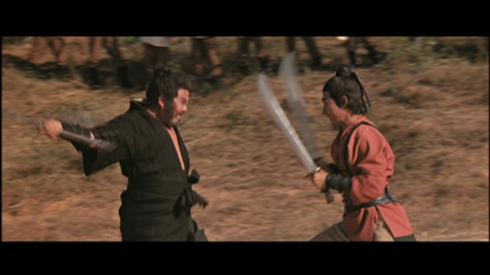 Black Whirlwind (Fan Mei-sheng, left) swings into action in THE WATER MARGIN, aka SEVEN BLOWS OF THE DRAGON
