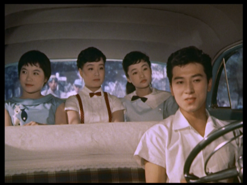 Akira Takarada drives the girls to his Grandpa's house. Notice how they all sit in the back with each other.