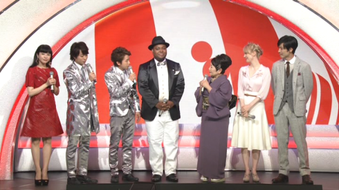 "Chris Hart, center, in black jacket; Charlotte Kate Fox, second from right, onstage in the New Year's Eve music special, ""Kohaku Uta Gassen"""