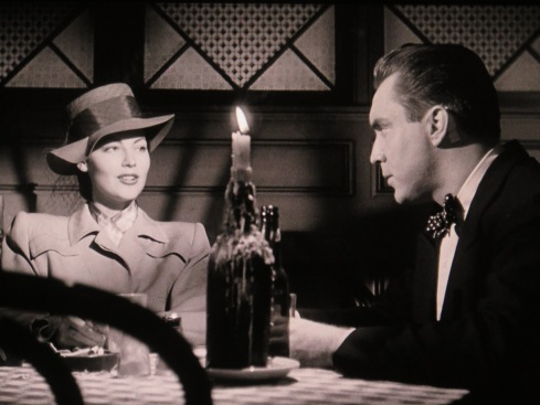 O'Brien questioning his murdered client's one-time lover (Ava Gardner) in THE KILLERS