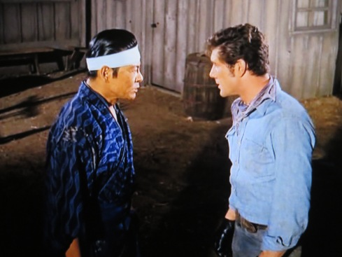 Robert Kino as Tomomi (left):